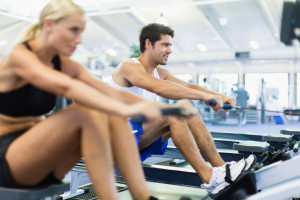 Couple-using-rowing-machines-in-gym