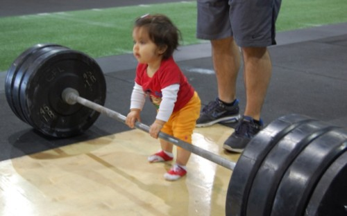 baby lifting weights
