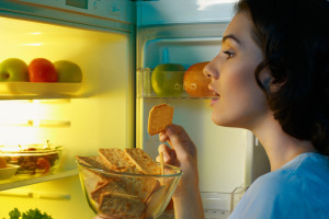 girl looking in refrigerator