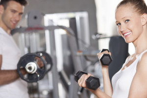 Couple-working-out-with-dumbbells-Move-It-Monday