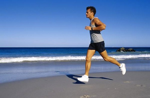 man running on the beach alone