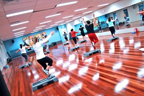 Group of people doing step aerobics