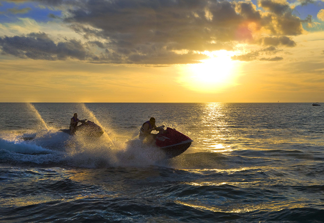 jet skiing at sunset