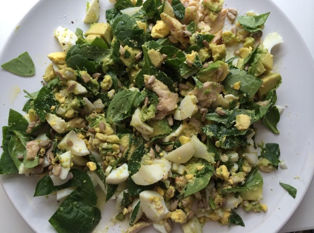Salad with spinach, grilled chicken, hard boiled egg, avocado, sun flower seeds and a little EVOO.