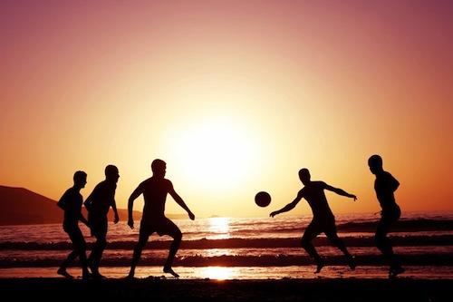 Soccer at sunset on beach