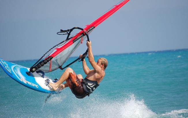 man windsurfing