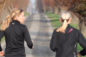 Two Women running on path