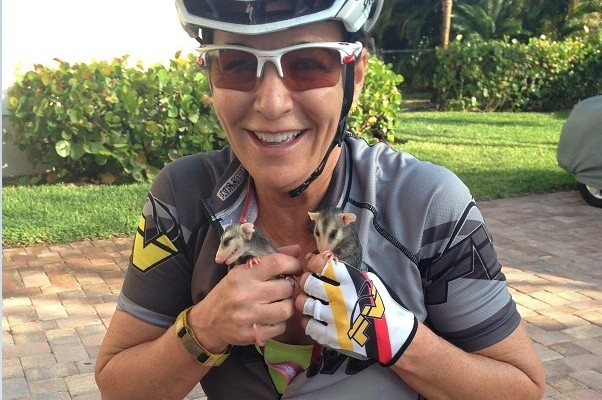 Tish Kelly with two opossums she rescued
