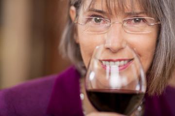 older woman drinking red wine