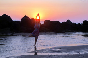 girl doing tree pose on the beach by Christopher Porter - Flickr