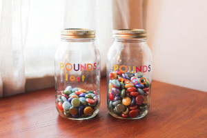 Colorful weight loss marbles in jars - Flickr - Melanie Levi