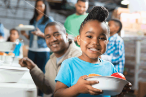 Preschool-age-African-American-child-at-soup-kitchen-with-family-000031240604_XXXLarge