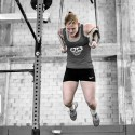 Woman doing Muscle Up