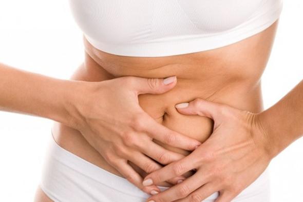 Women grabbing stomach